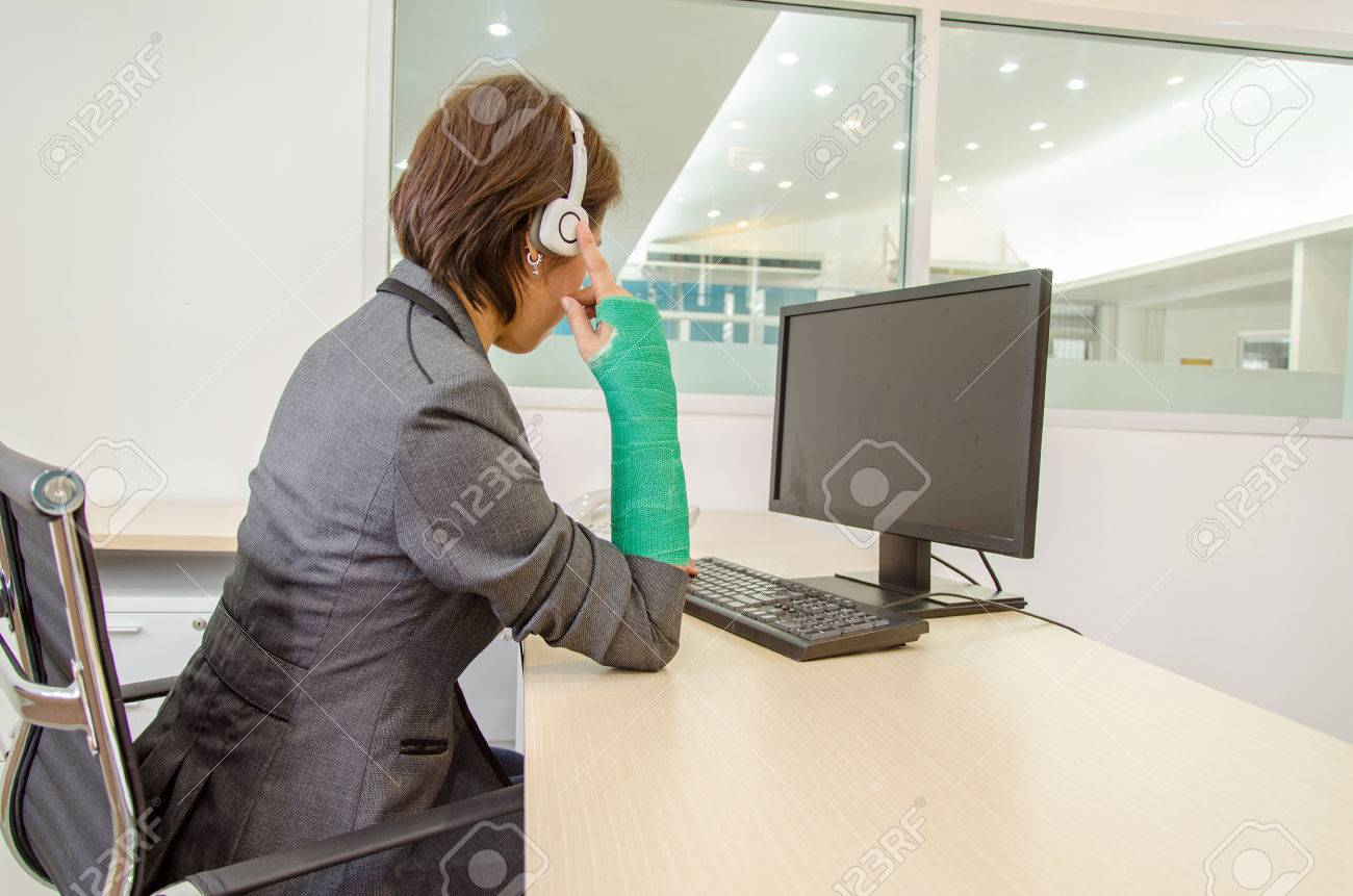 Injured Businesswoman With Green Cast On The Wrist Touching