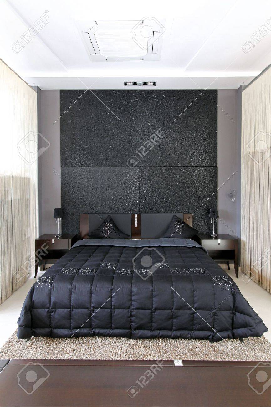 Modern Small Bedroom modern small bedroom interior with large double bed stock photo