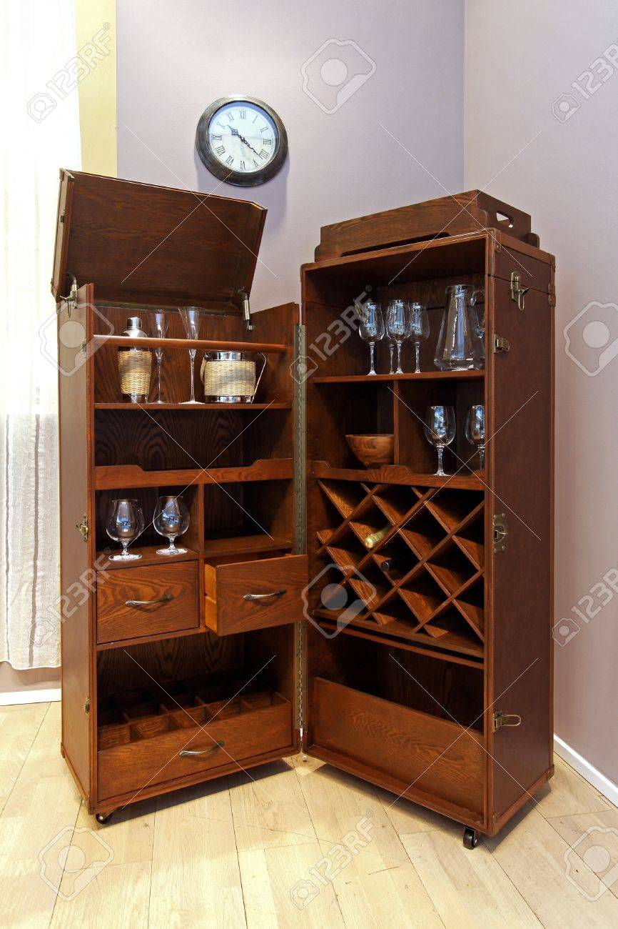 Stock Photo   Wooden portable home bar with wheels in corner of room. Wooden Portable Home Bar With Wheels In Corner Of Room Stock Photo