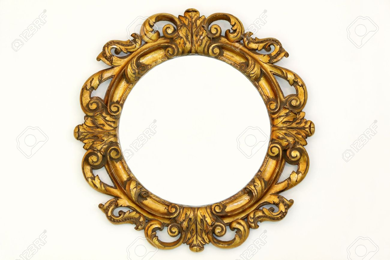 oval gold baroque style frame on beige wall stock photo picture and