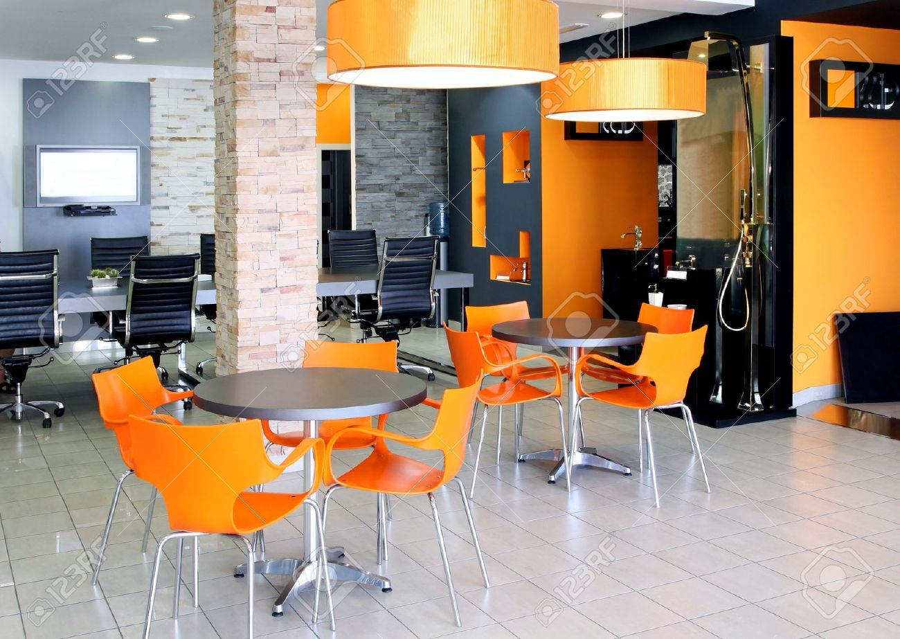 Modern Office Space With Bright Orange Furniture Stock Photo