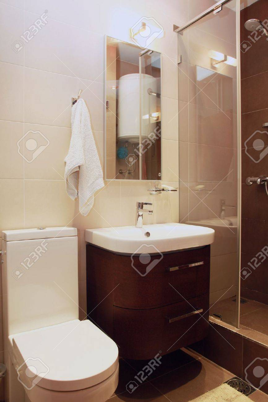 small modern bathroom interior with brown tiles stock photo