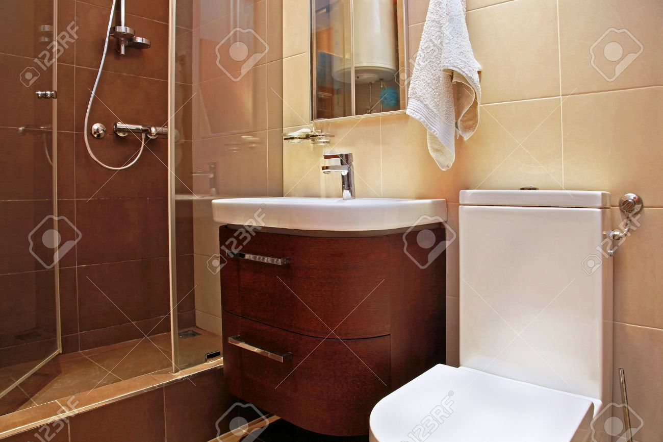 Small modern bathroom interior with brown tiles Stock Photo - 17153537
