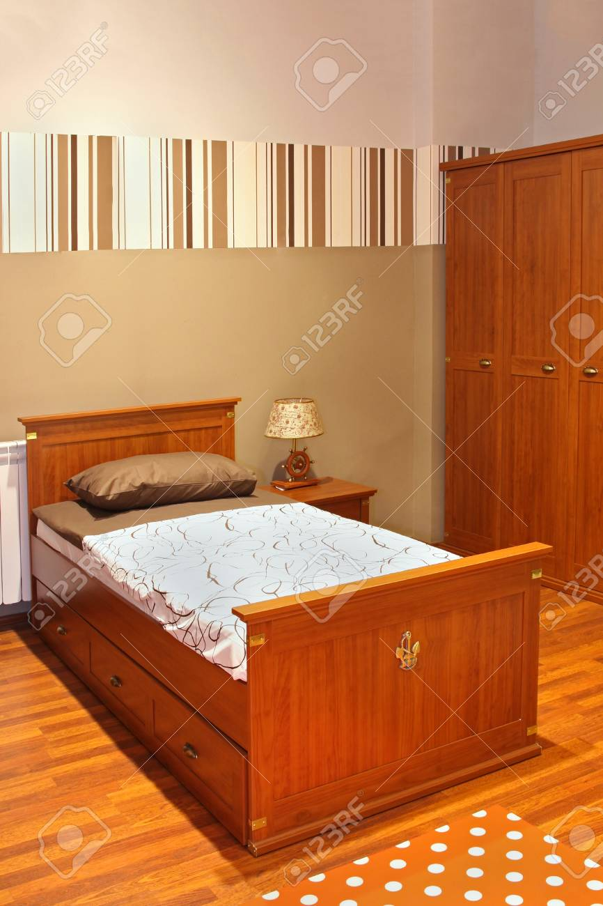 Modern school child bedroom interior with brown furniture Stock Photo - 20893407