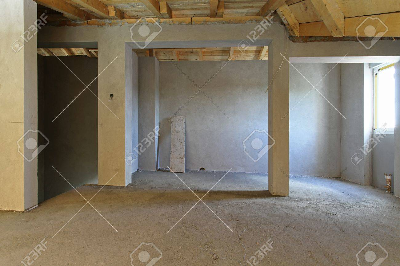 Empty unfinished house interior during construction works
