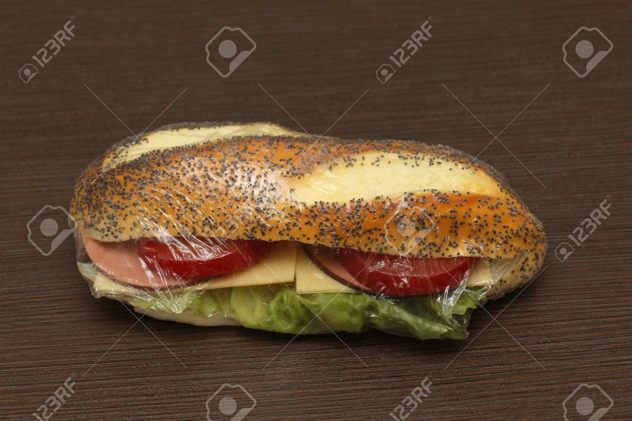 Healthy Ham And Tomato Sandwich Inside Cellophane Wrap