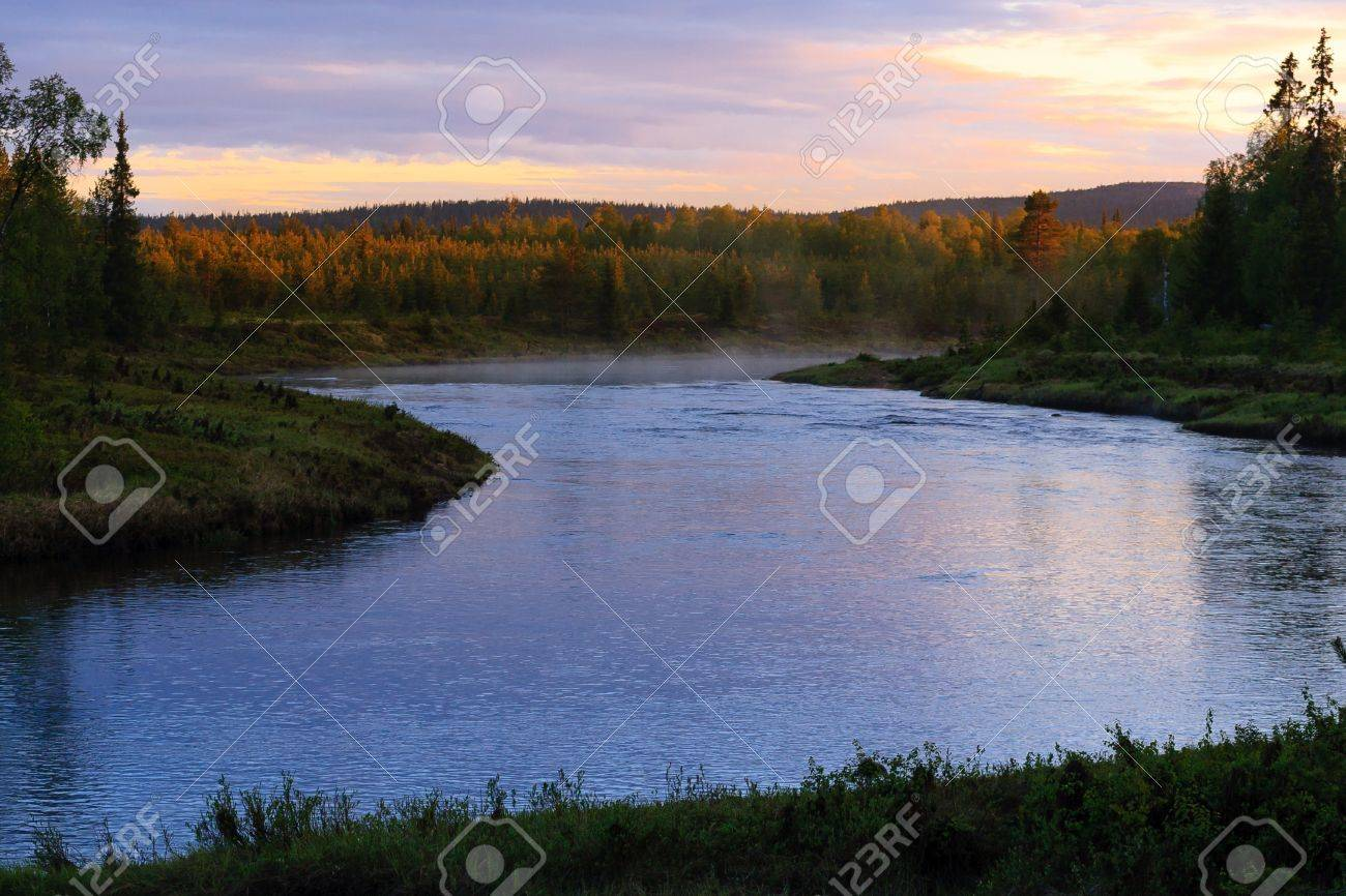 Steaming river on a very bright night in Finnish Lapland Stock Photo - 17070322