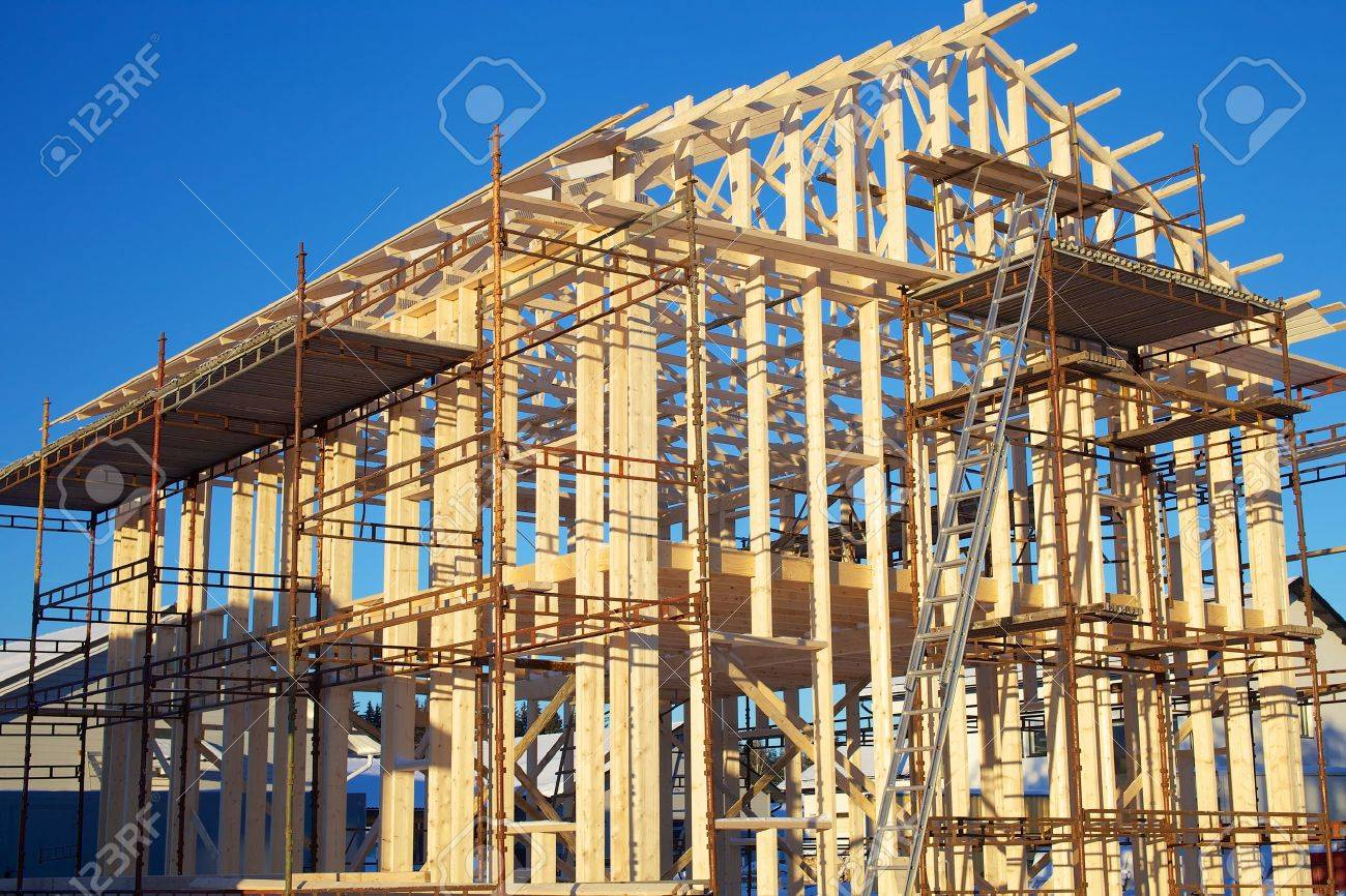 Residential construction site with incomplete home framing and scaffolds Stock Photo - 19462285