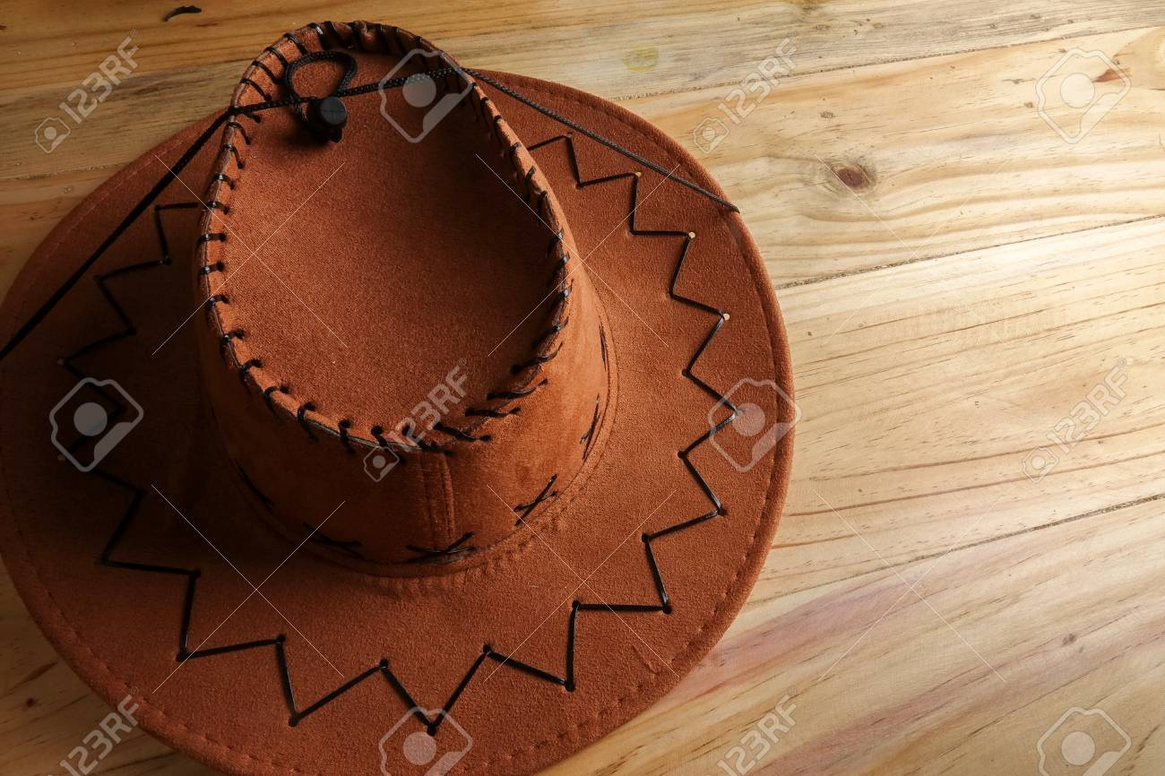 Cowboy hat on a wooden table. Side lighting effect and copy space Stock  Photo - 75bc1d7802c