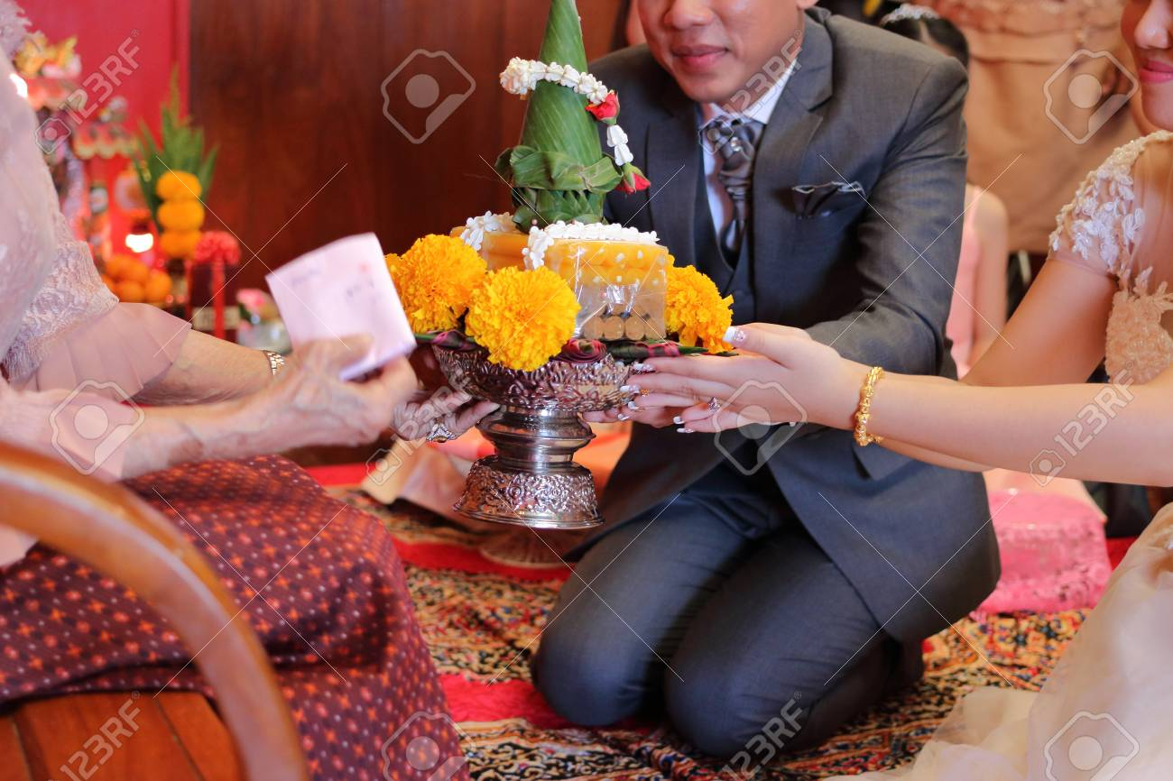 Groom And Bride Holding Wedding Gift In Traditional Thai Wedding