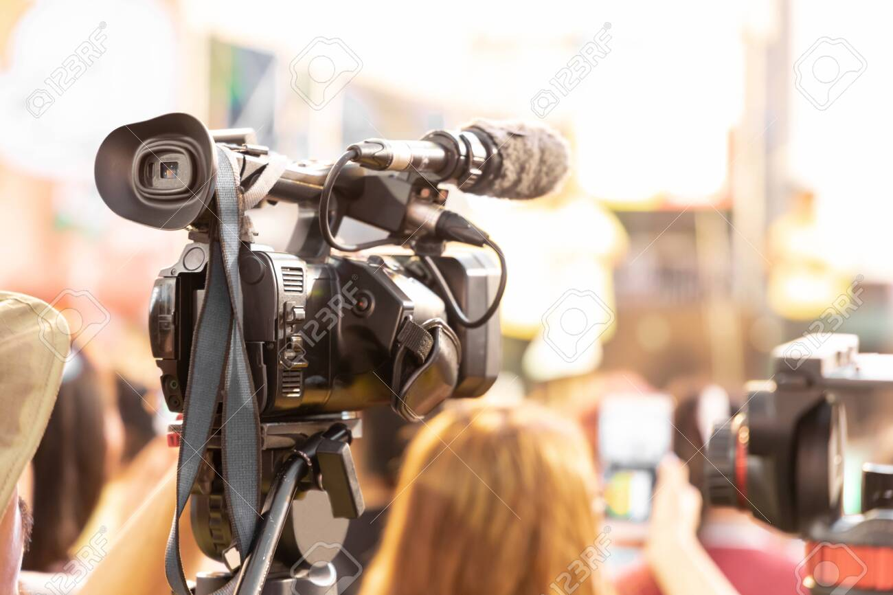 Professional digital video camera technician. Videographer with equipment at event. - 141790937