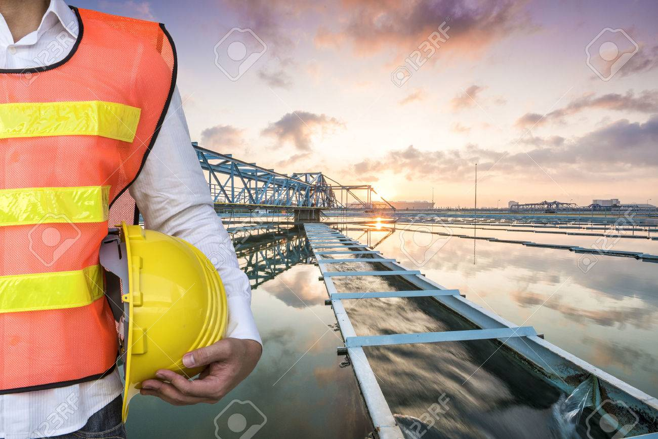 Engineer with The Solid Contact Clarifier Tank type Sludge Recirculation process in Water Treatment Plant with Sun Rise - 50103315