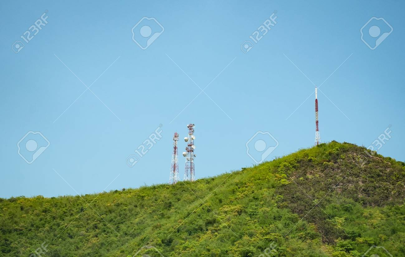 Radio, repeater or communication antenna tower, over the hill