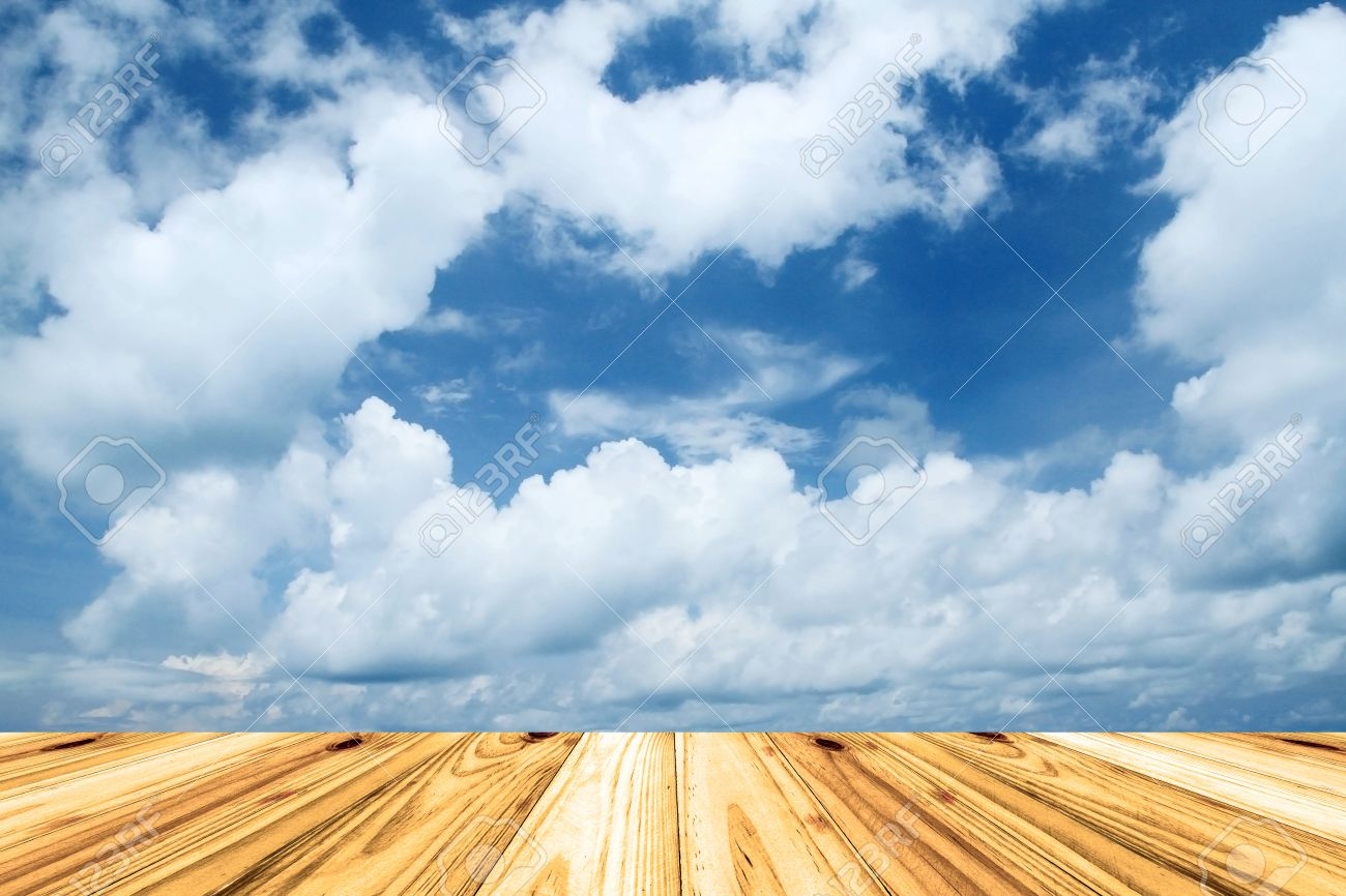 wooden floor with beautiful blue sky scenery for background stock