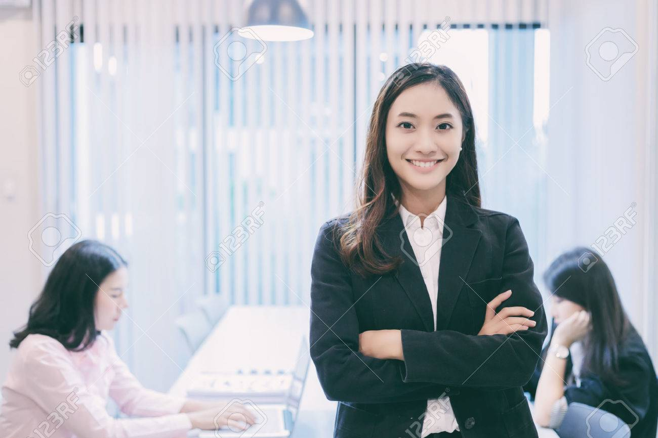 Asian business women and group using notebook for meeting and business women smiling happy for working - 81617901