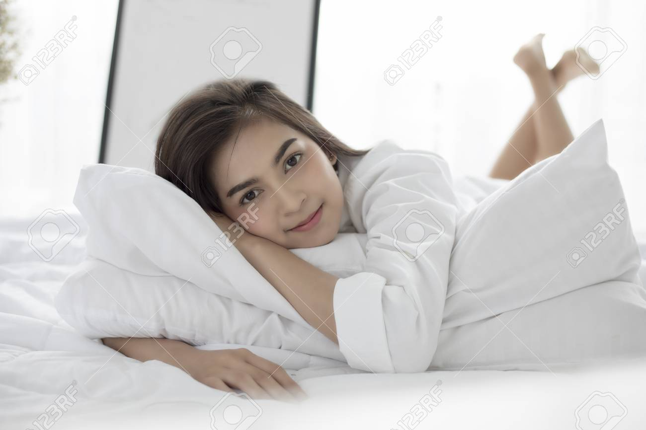 Asian woman in bed