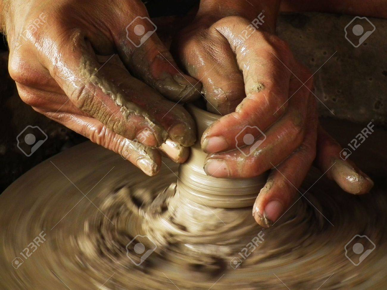 Close-up of potter turning a pot on a potter's wheel Stock Photo - 12407286