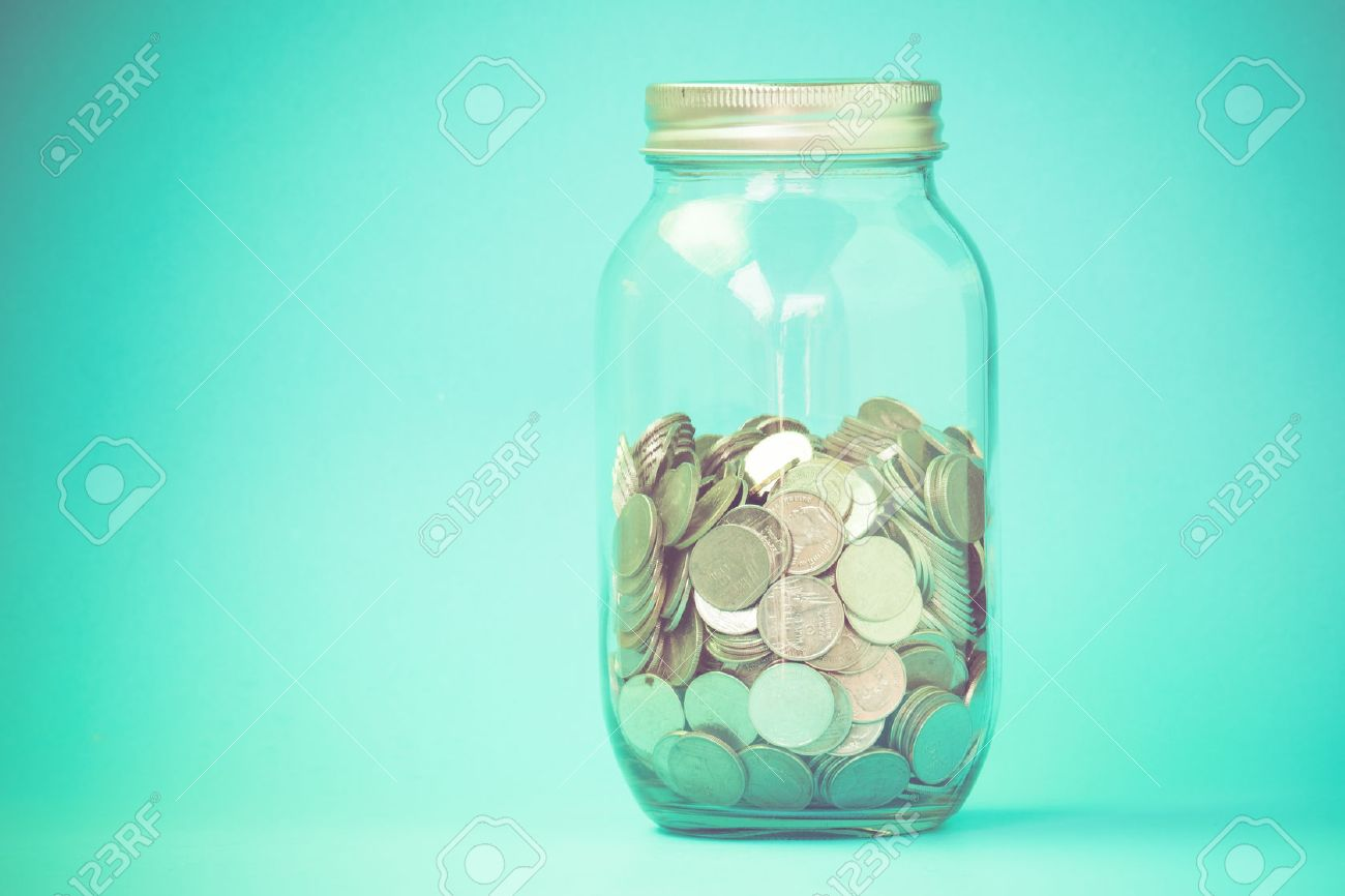 money in the glass with filter effect retro vintage style Stock Photo - 39965380