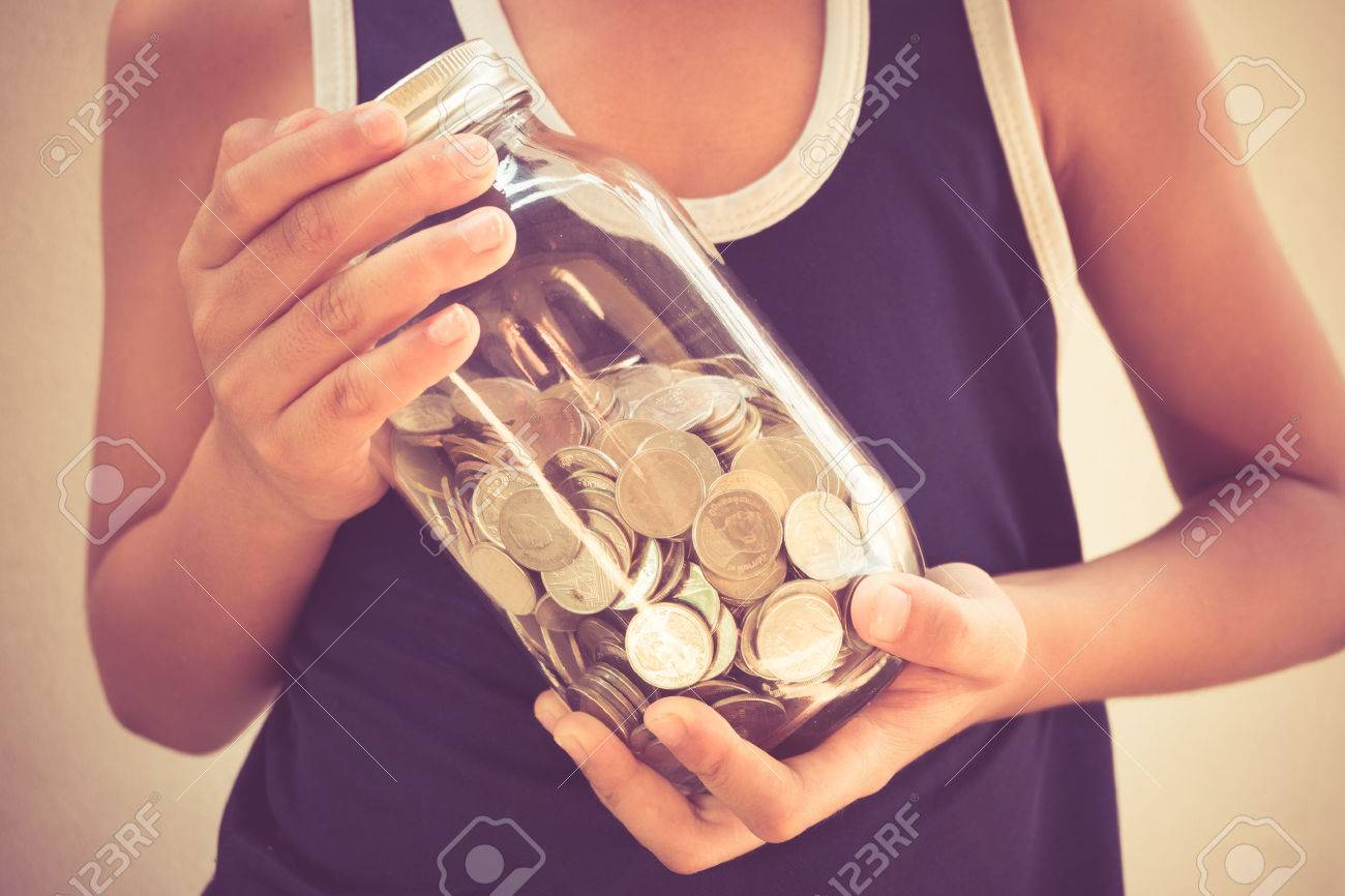money in children's hands with filter effect retro vintage style Stock Photo - 39964867