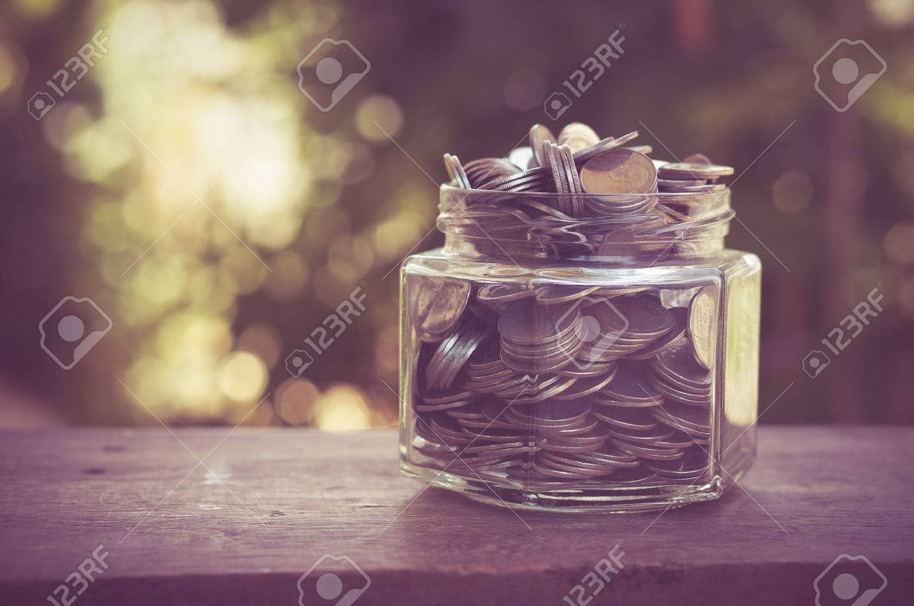 money in the glass with filter effect retro vintage style Stock Photo - 42736506