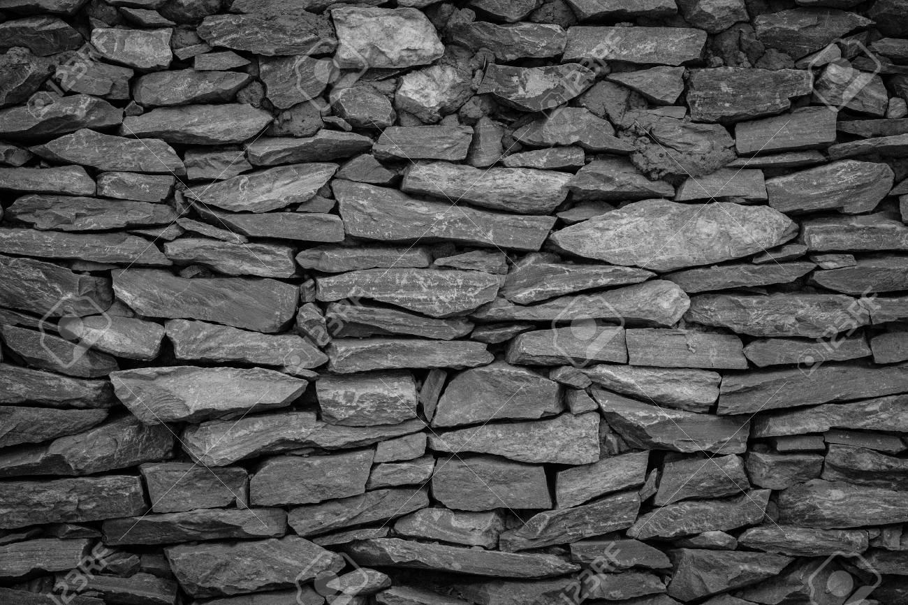 Schwarz Wand Stein Hintergrund Lizenzfreie Fotos Bilder Und Stock