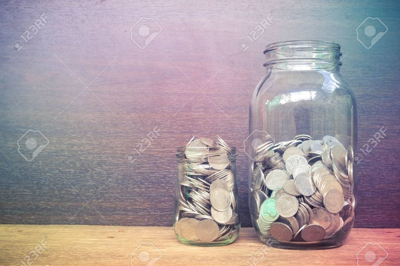 money in the glass with filter effect retro vintage style Stock Photo - 43788123
