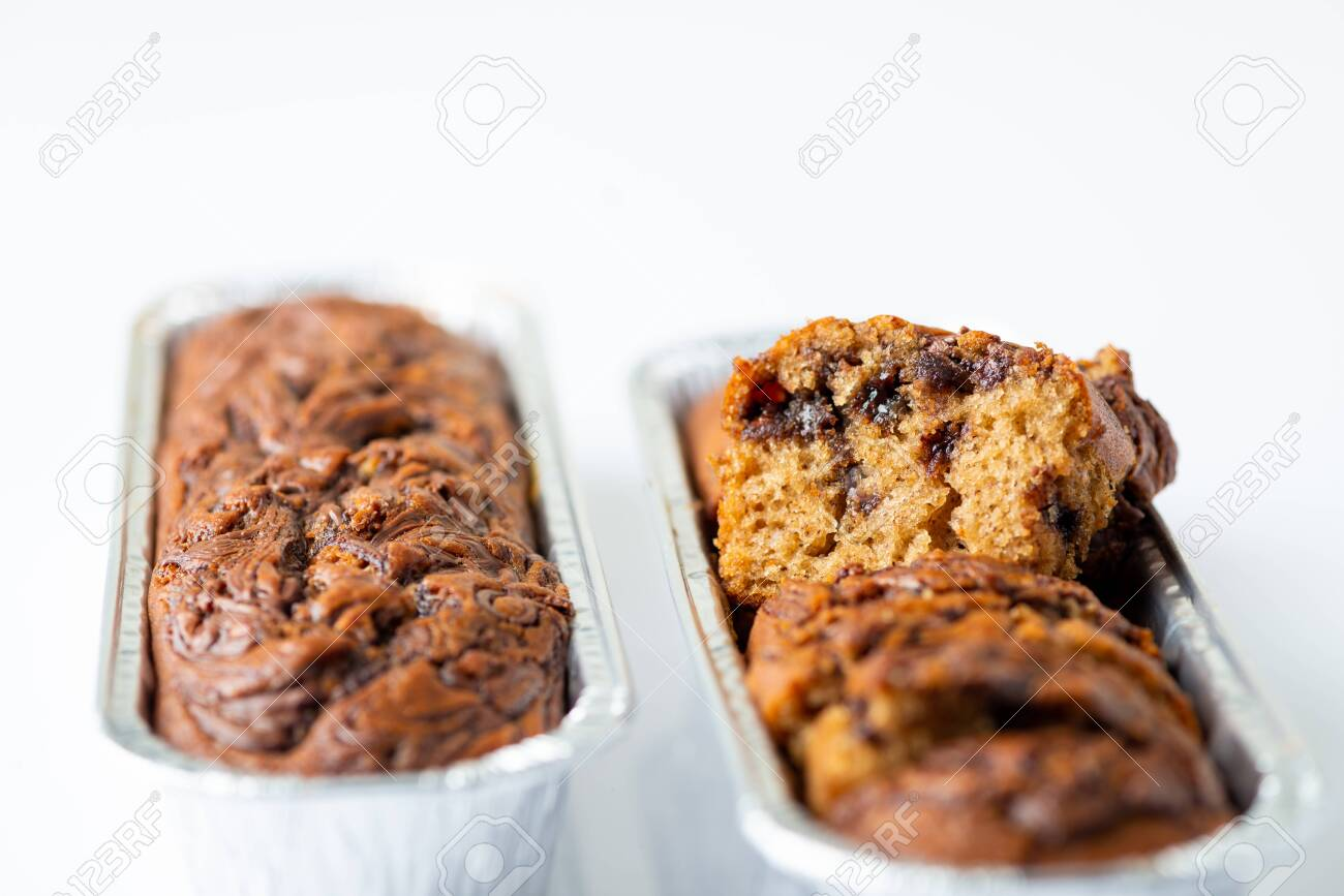 Delicious chocolate banana cake on white background. Selective focus - 121079265
