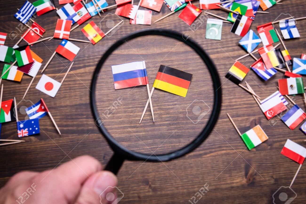 Russian and German flags. Politics, economics, imports and exports concept - 132839429