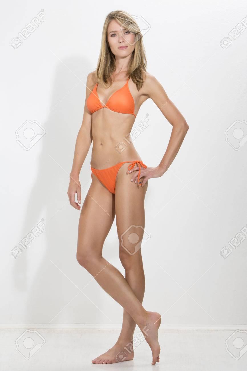 Blonde girl in orange bikini
