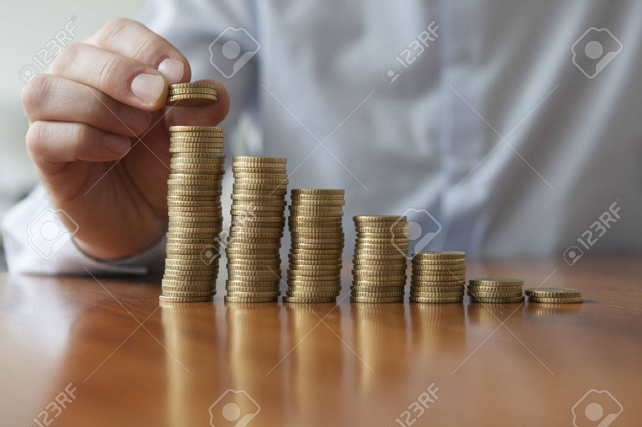 Finances, Person stacking Euro coins, close-up - 36677703