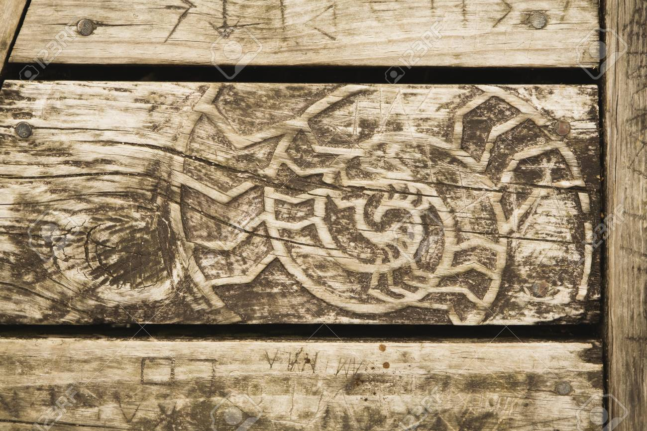 Wooden bench with woodcarving stock photo picture and royalty free
