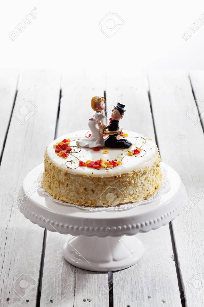 Wine Cream Cake, Wedding Cake With Figurines, Bride And Groom Stock ...
