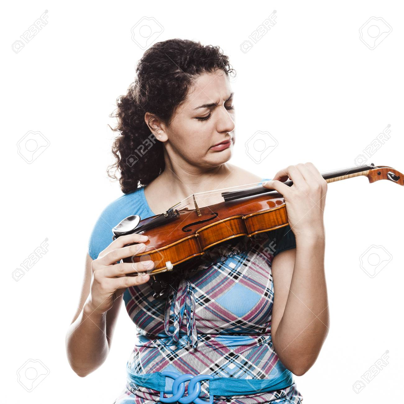 Emotional young violinist playing music