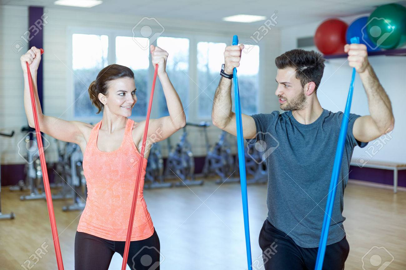 Couple Training In Fitness Studio With Resistance Band Stock Photo Circuit Bands 44507046