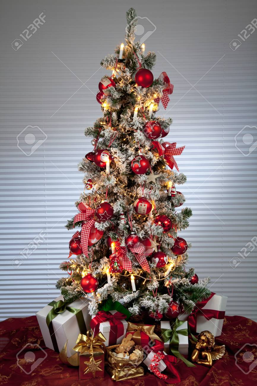 Decorated Christmas Tree With Electric Candles And Presents