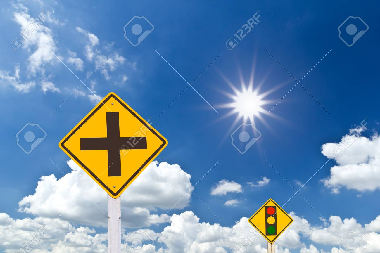 intersection warning sign in blue sky Stock Photo - 8248184