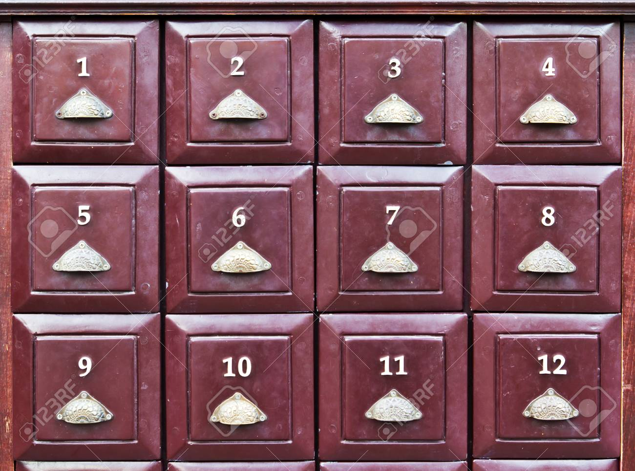 row of twelve brown wood drawer Stock Photo - 8428659