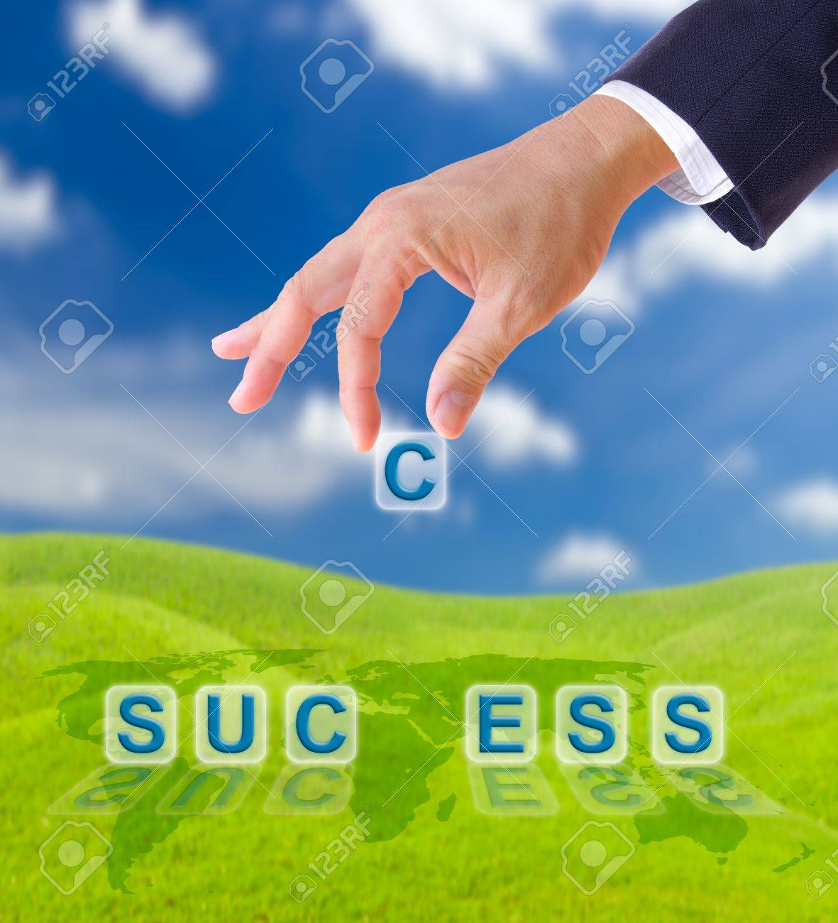 hand puting letter c to  success word on blue sky , business concept Stock Photo - 9943498
