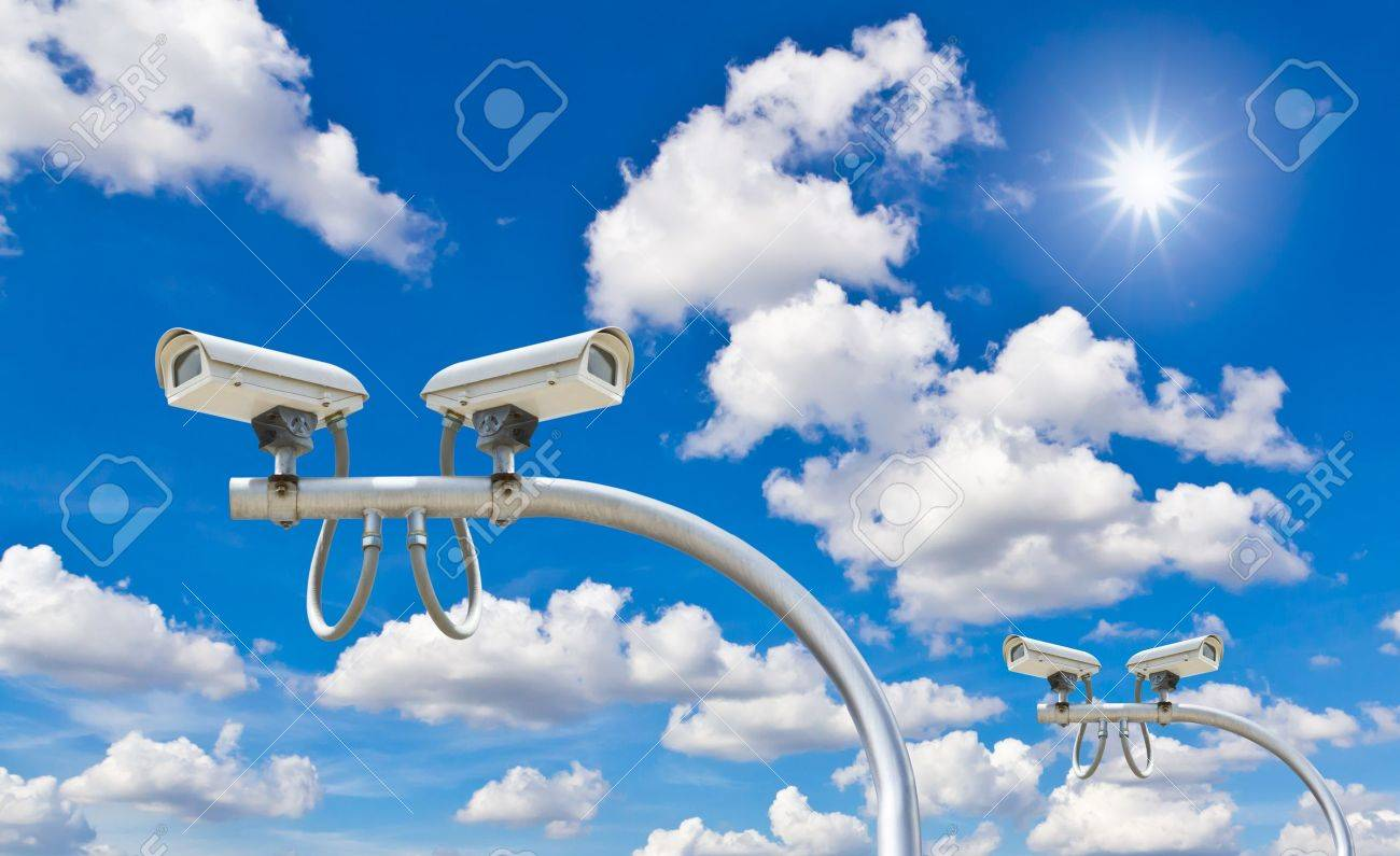 outdoor security cctv cameras against blue sky and sunshine Stock Photo - 10750812