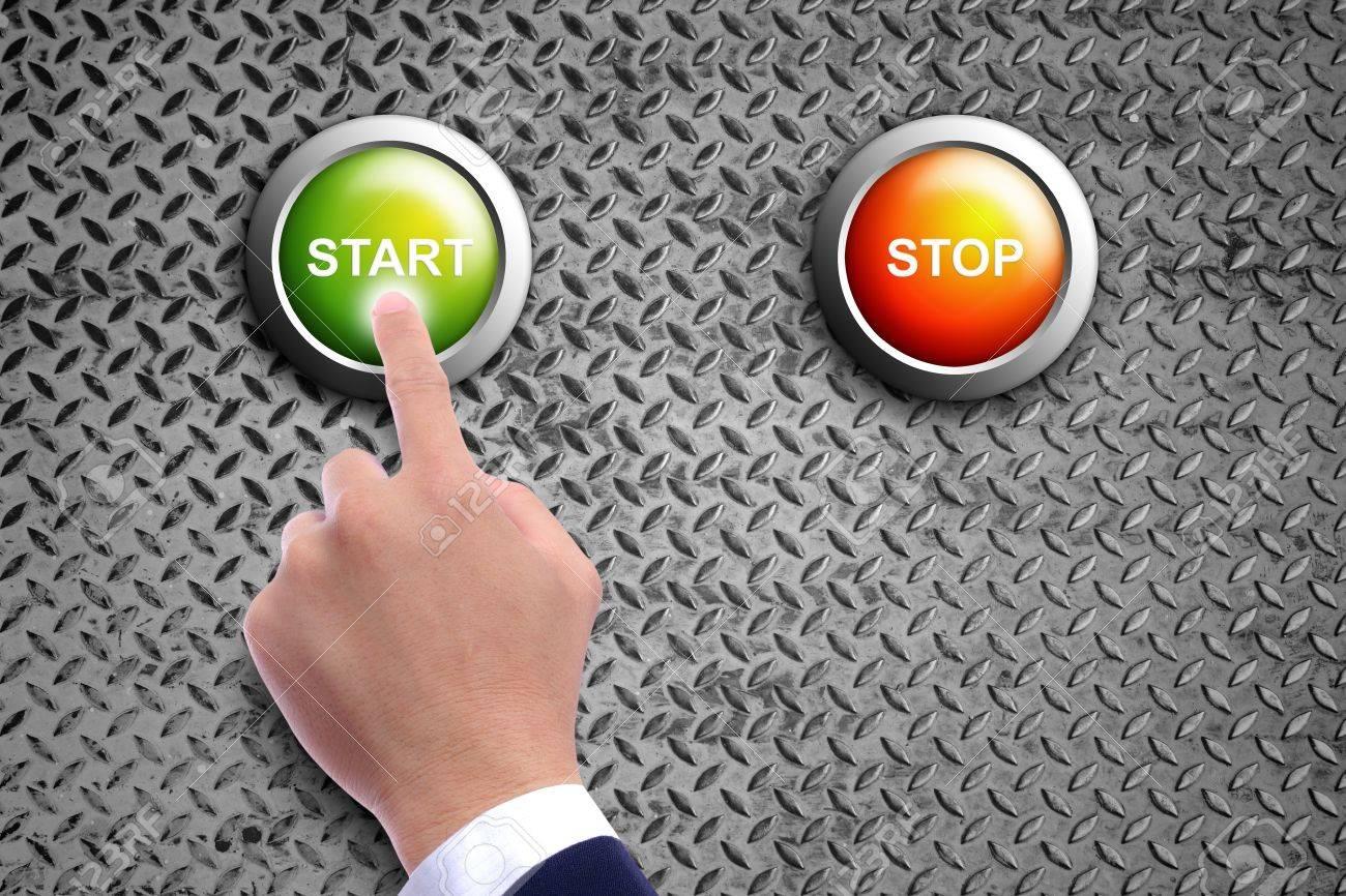 hand pushing start button on diamond steel background Stock Photo - 11201808
