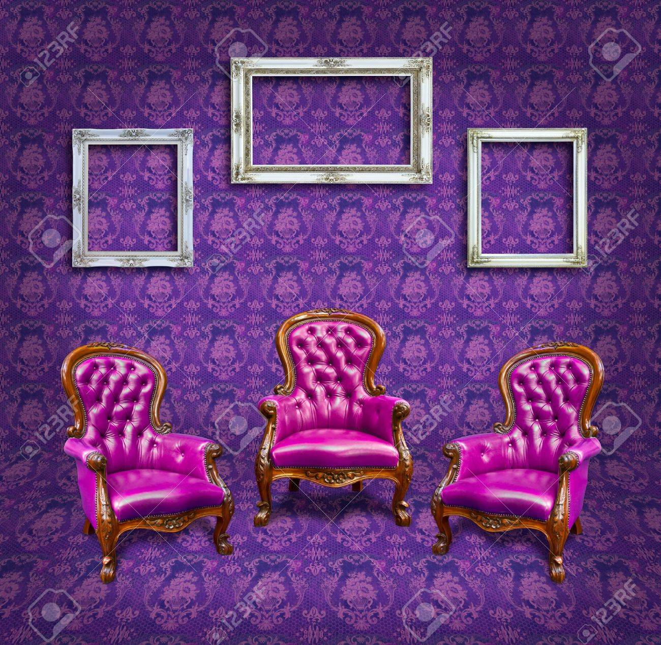 armchair and frame in purple room Stock Photo - 12764777