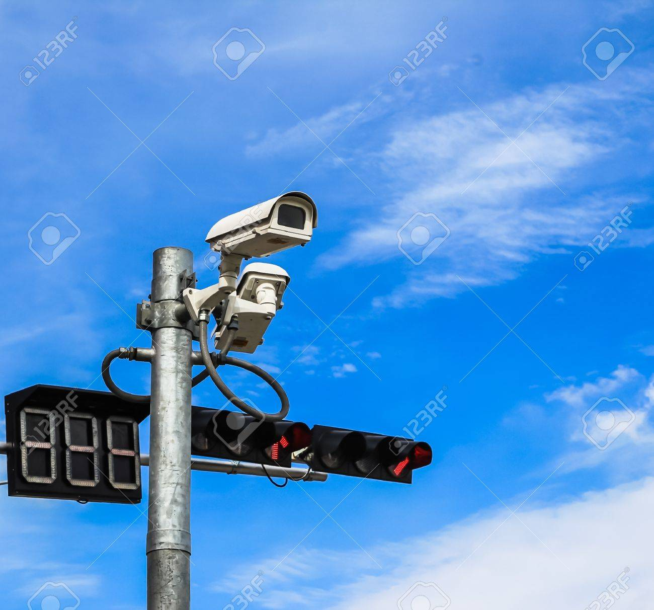surveillance camera and traffic light against blue sky Stock Photo - 17679916
