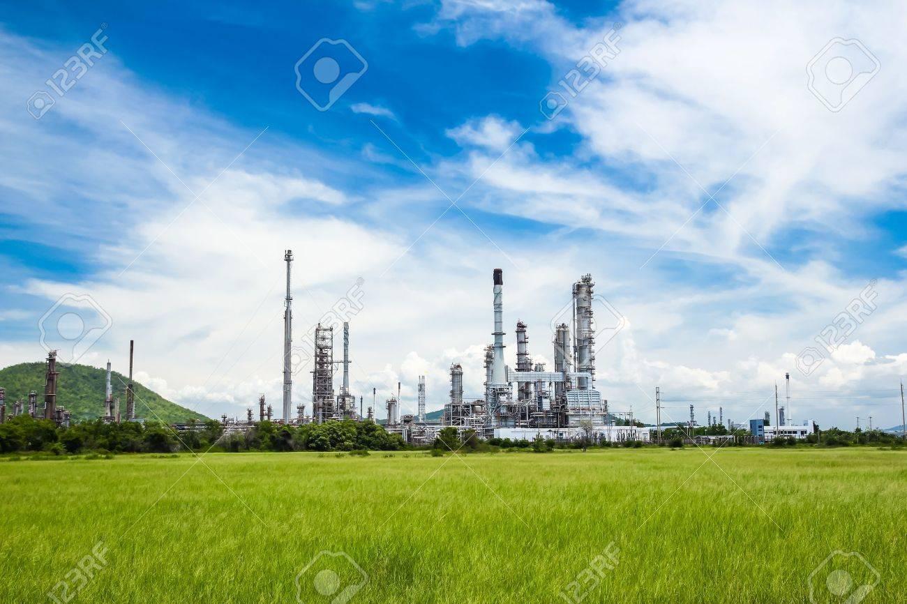 oil refinery plant against blue sky - 17679994