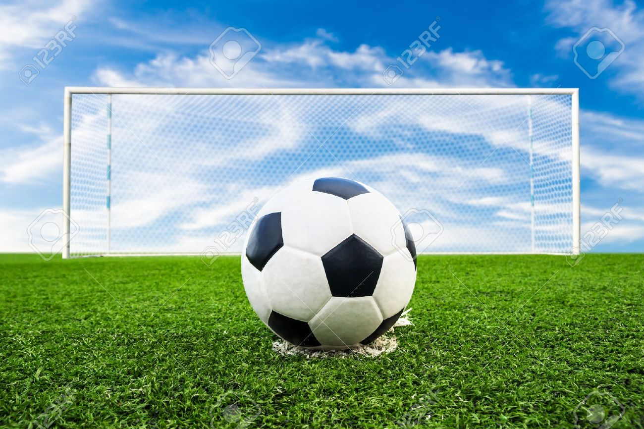 grass soccer field with goal.  Goal Soccer Ball On Green Grass Field Stock Photo  20557392 Inside Grass Soccer Field With Goal 123RFcom
