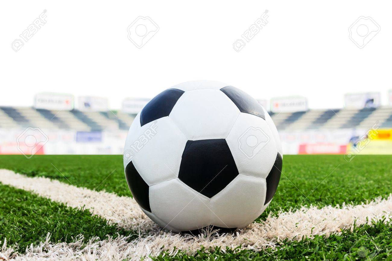 soccer ball on green grass field isolated on white background Stock Photo - 21806518