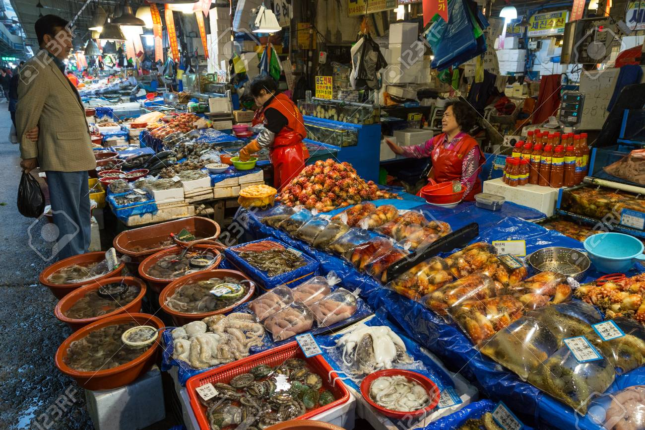 All kind of seafood being sold and people at the Noryangjin Fisheries