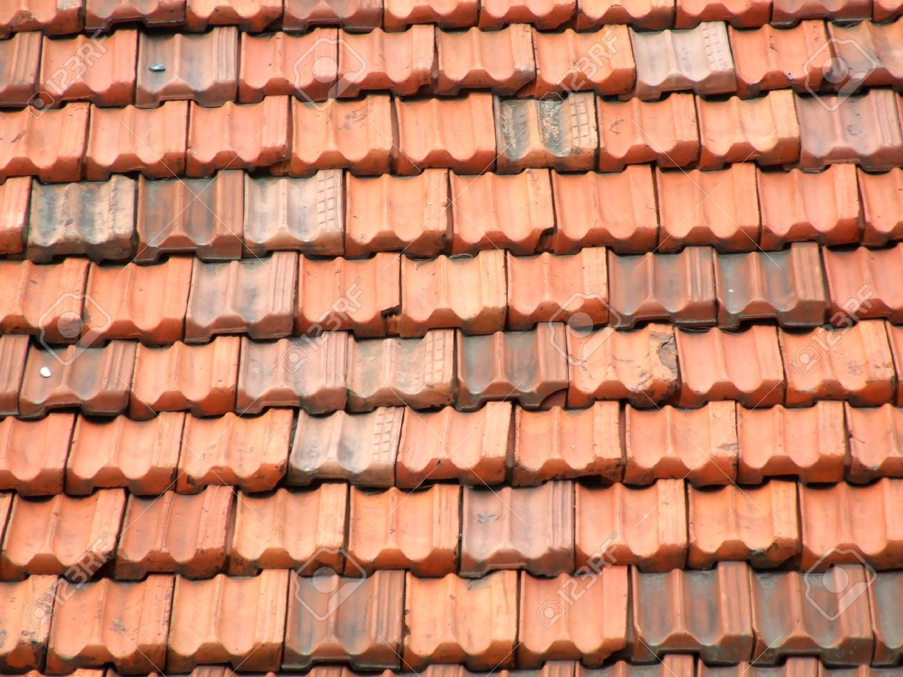 Red and orange roof tiles on an Italian residential building in a small town. Ceramic slate roof. Stock Photo - 1717157