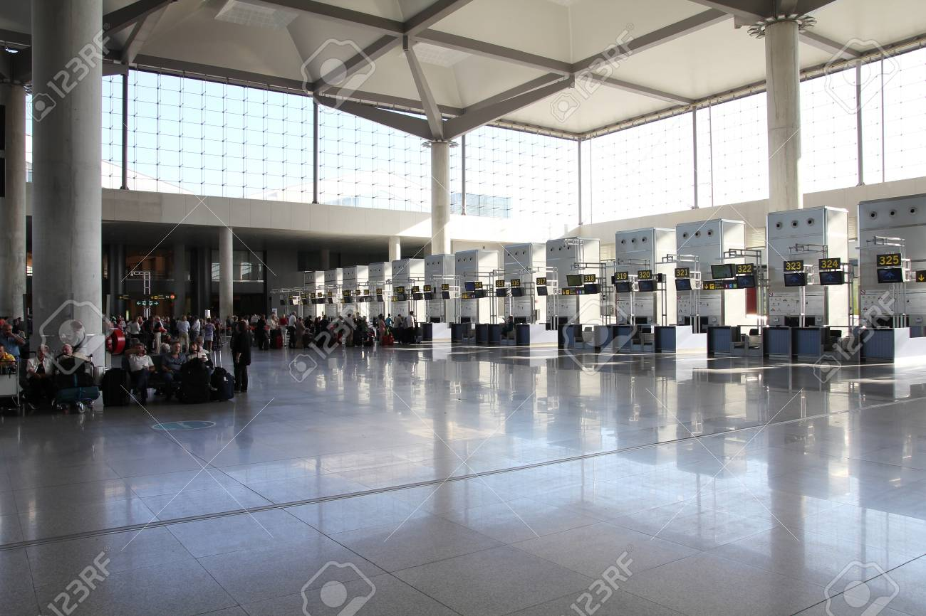 MALAGA - OCTOBER 14: Travelers on October 14, 2010 at Malaga International Airport. Malaga, which was 4th busiest airport in Spain in 2009, had 10 new routes announced on November 3, 2010. Stock Photo - 9541797