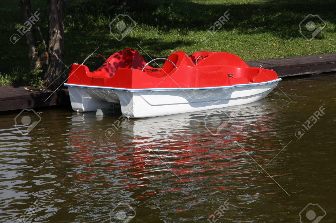 Masuria (Mazury) - famous lake district in Poland. Red paddle boat (pedalo). Wydminskie lake. Stock Photo - 10749143