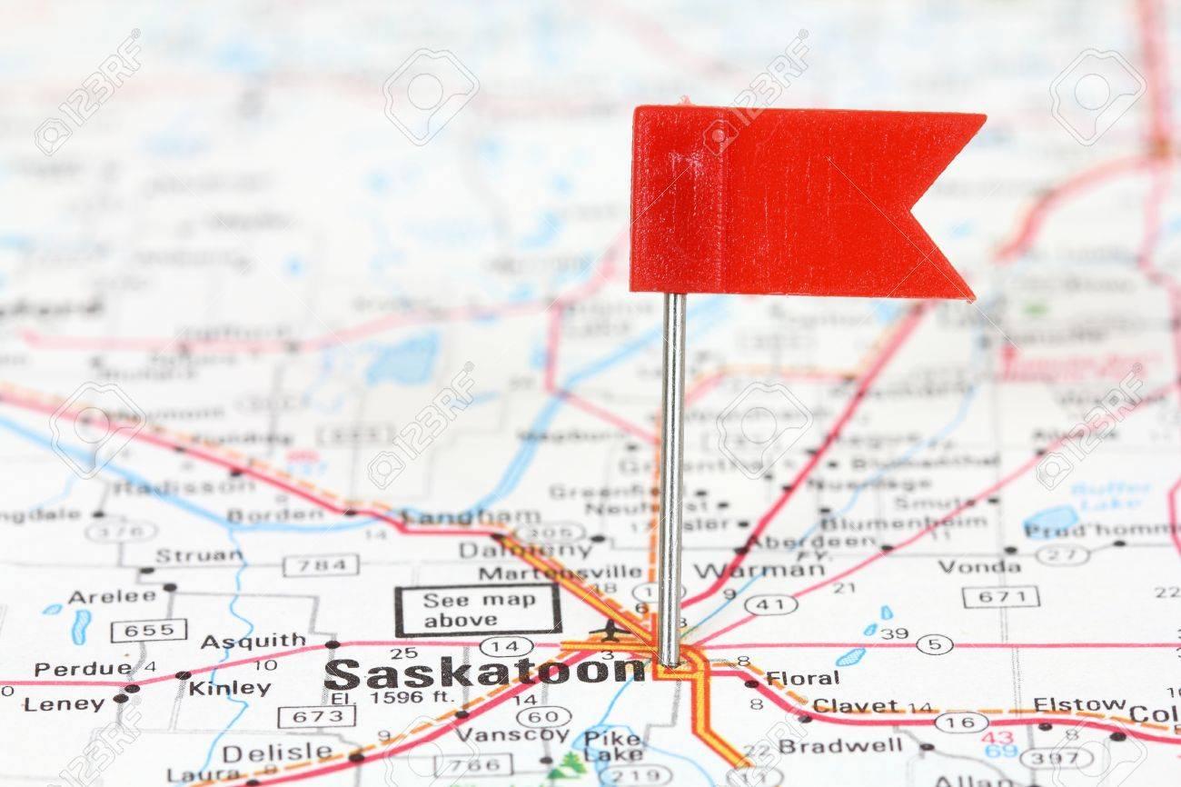Saskatoon In Saskatchewan Canada Red Flag Pin On An Old Map